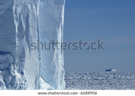 Iceberg wall in Antarctica - stock photo