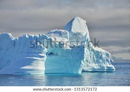 Icebergs drift in the ocean. #1313572172