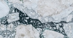 Icebergs drone aerial photo top view - Climate Change and Global Warming - Icebergs from melting glacier in icefjord in Ilulissat, Greenland. Arctic nature ice landscape in Unesco World Heritage Site.