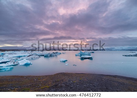 Icebergs floating in Fjallsarlon glacier lake at sunset. South Iceland.Close to Jokulsarlon lagoon./ Icebergs floating in Fjallsarlon glacier lake at sunset. #476412772