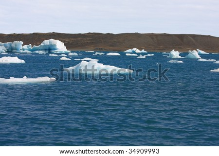 Icebergs floating toward the ocean.