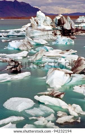 stock-photo-icebergs-in-the-glacier-lake-jokulsarlon-iceland-94232194.jpg