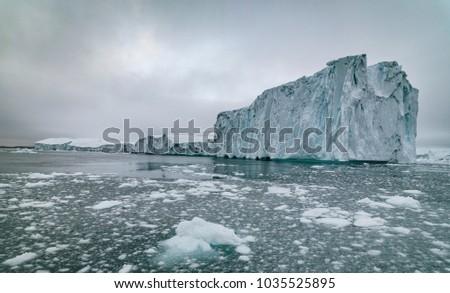 Icebergs on arctic ocean in Ilulissat icefjords in Greenland #1035525895