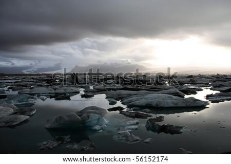 Icebergs on Jokulsarlon lagoon in Iceland. Famous lake. Travel destination for tourists next to Vatnajokull glacier. Sunset.