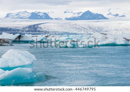 Icebergs swimming on world famous Jokulsarlon glacier lagoon in southern Iceland #446749795