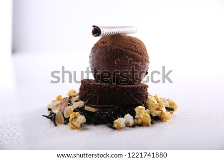 Icecream scoop with crushed nuts brownie creamy milky chocolate coffee flavour tasty healthy beautiful decoration food photography awsome romantic gourmet brown iced nutrition
