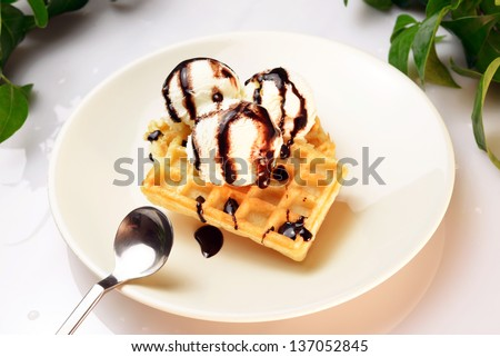 Icecream with waffle and chocolate topping