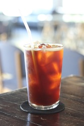 Iced americano coffee with ice on table in cafe.