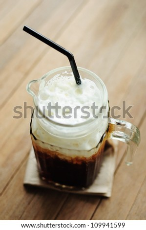 iced black coffee  on wooden table