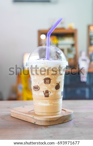 Iced cappuccino coffee frappe in cafe #693971677