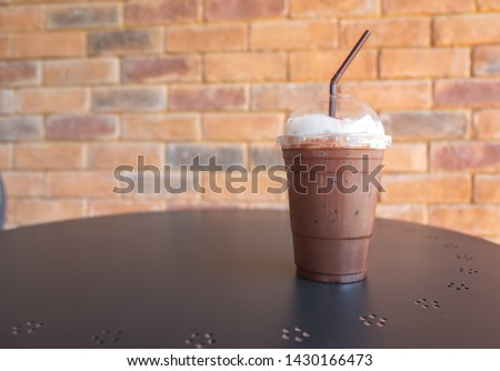Iced chocolate glass on table with copy space in cafe restaurant #1430166473