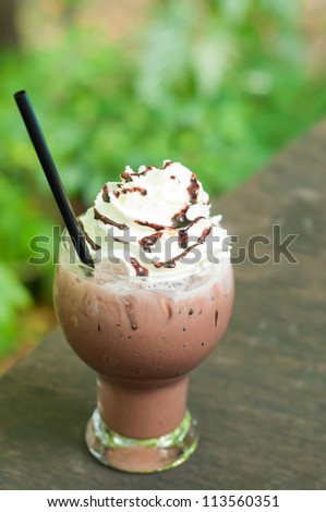 iced chocolate with whipped cream in outdoor cafe