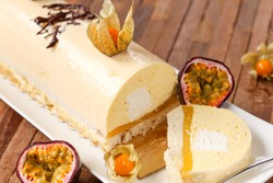 iced christmas log with coconut passion fruit and vanilla
