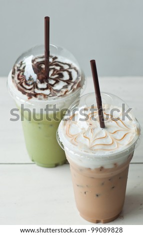 iced coffee and iced green tea on table