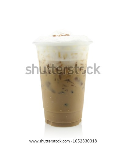 Iced coffee covered with whipped cream in plastic glass isolated on white background. #1052330318