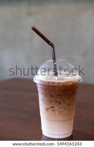 Iced coffee in plastic cup on wooden table, copy space #1494161243