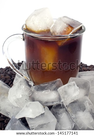Iced coffee on bed of beans with ice