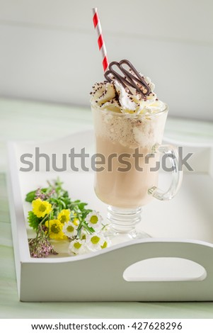 Iced coffee with whipped cream in summer #427628296