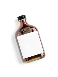 Iced cold brew coffee in blank label bottle isolated on white background.