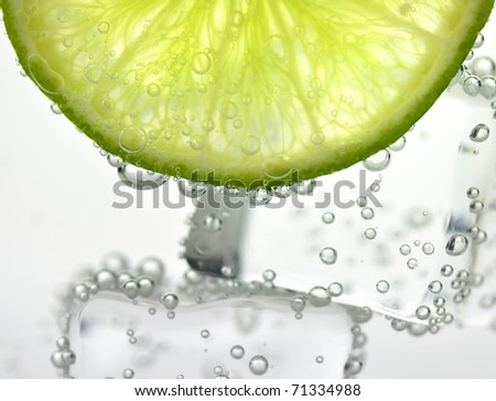 iced drink with lemon , close up