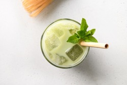 Iced Green matcha tea in glass decorated mint isolated on white table. View from above. Horizontal orientation. Close up