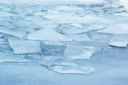 Iced lake surface, frozen river with ice tiles