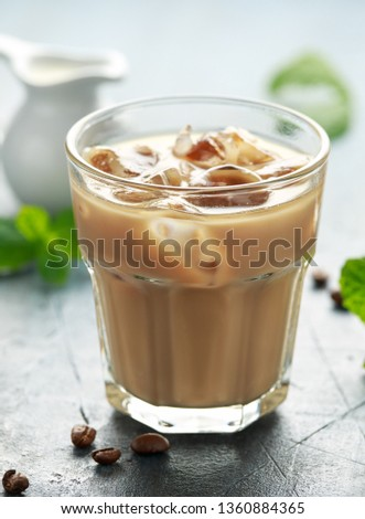 iced latte coffee in a glass with cold milk. Summer drink #1360884365