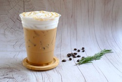 Iced latte coffee with Caramel and Coffee beans