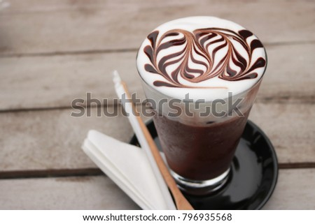iced mocha coffee. Mocha coffee put in ice in glass. Then make-up beautiful art on top. #796935568