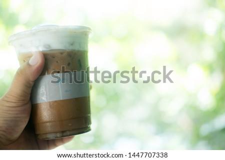 Iced mocha coffee on hand. Morning refreshing drink. #1447707338