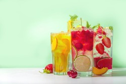 Iced refreshing drink. Bar and cafe beverage menu background. Set of various cold summer cocktails  - peach tea, lemonade, mojito, cherry mocktail, with fruits on colorful bright green background