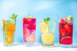 Iced refreshing drink. Bar and cafe beverage menu background. Set of various cold summer cocktails  - peach tea, lemonade, mojito, cherry mocktail, with fruits on colorful bright blue background