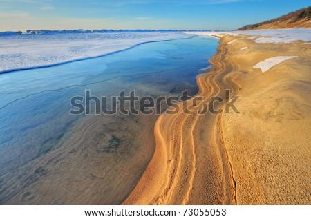 Iced shoreline of Lake Michigan near sunset, Saugatuck Dunes State Park, Michigan, USA