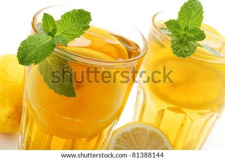 Iced tea with lemon isolated on white .. - stock photo