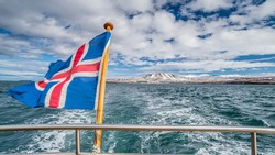 Iceland flag on boat while leaving shore