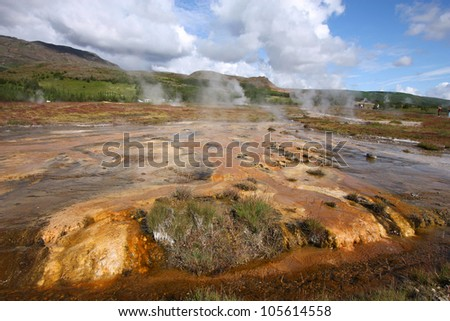 Iceland - Geothermal activity near Geysir. Colorful soil and steaming hot springs. Travel destination.