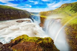 Iceland, Gullfoss waterfall. Captivating scene with rainbow of Gullfoss waterfall that is most powerful waterfall in Iceland and Europe. Picturesque summer scene with amazing Icelandic waterfall.