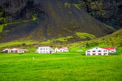 Iceland landscape view of old turf church in Hof town small village in summer on south southern ring road with green grass and farm houses