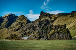 Iceland Landscape with green moss and view towards mountains clo