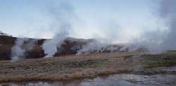 Iceland nature scenic landscape  with steaming geysers vapors