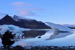Iceland - November 2 2018: Man taking a picture of Jokulsarlon Lake in Iceland