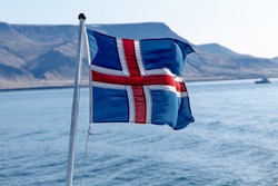 Icelandic flag flying on a boat.
