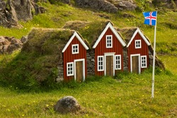 Icelandic houses with a flag of Iceland