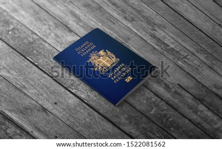 Icelandic Passport ,Official passport of Iceland on the top of an wooden background
