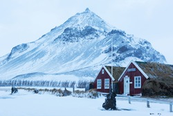 Icelandic turf houses in Arnarstapi. Arnarstapi or Stapi is a small fishing village, Snaefellsnes,  Iceland.