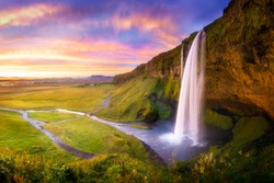 Icelandic waterfall Seljalandsfoss at sunset