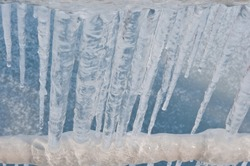 icicles above the frozen river