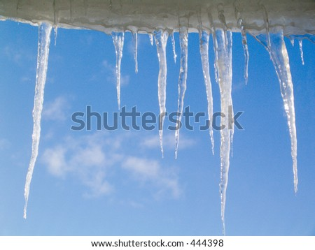 Icicles against a blue sky
