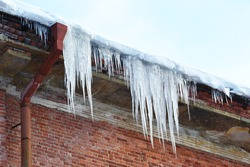 Icicles drooping from the roof.
