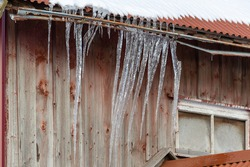 Icicles hanging from a roof on a barn. Shot in Sweden, Scandinavia